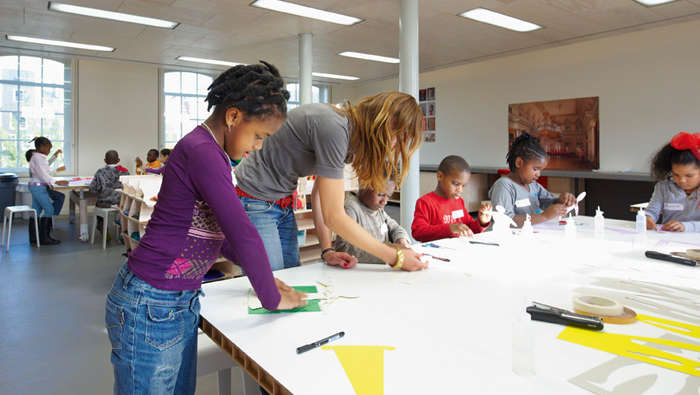 Students are having workshops in a class at Hermitage, Amsterdam illuminated with Philips energy-efficient lighting