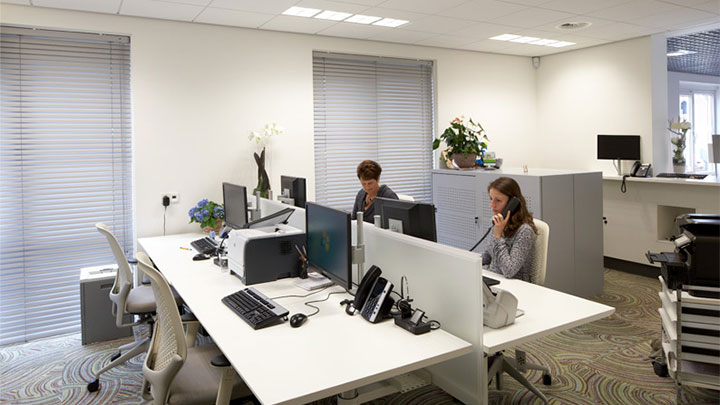 The office at Lindehof Health Centre illuminated by Philips
