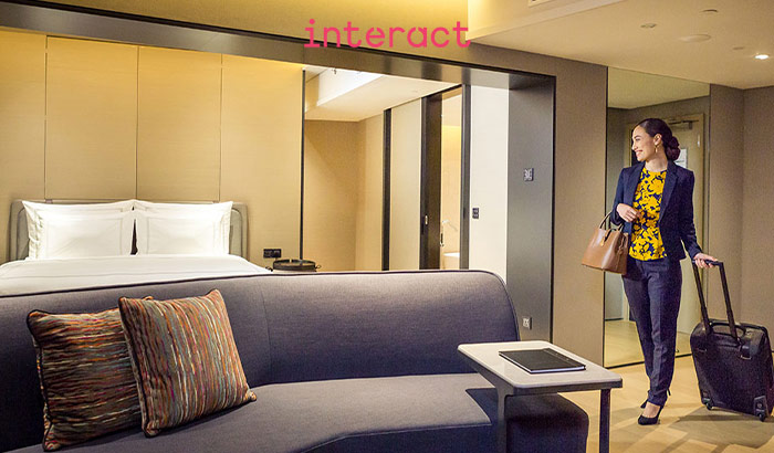 Interact Hospitality mood-enhancing lighting scenes in hotel guest room