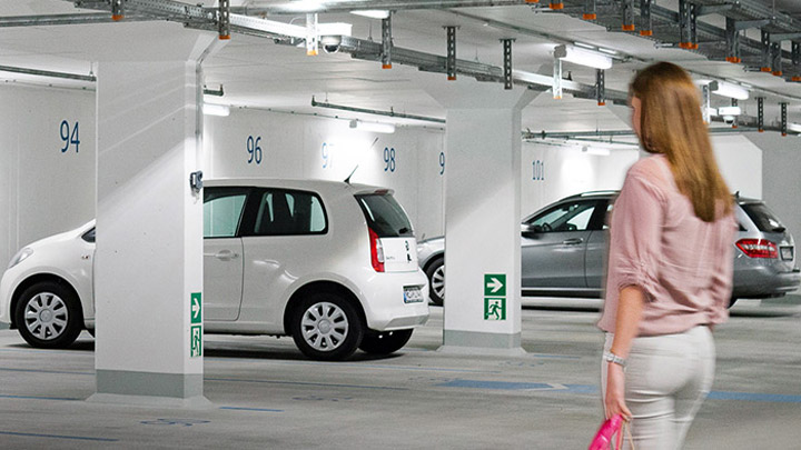 Woman in a carpark with GreenParking system