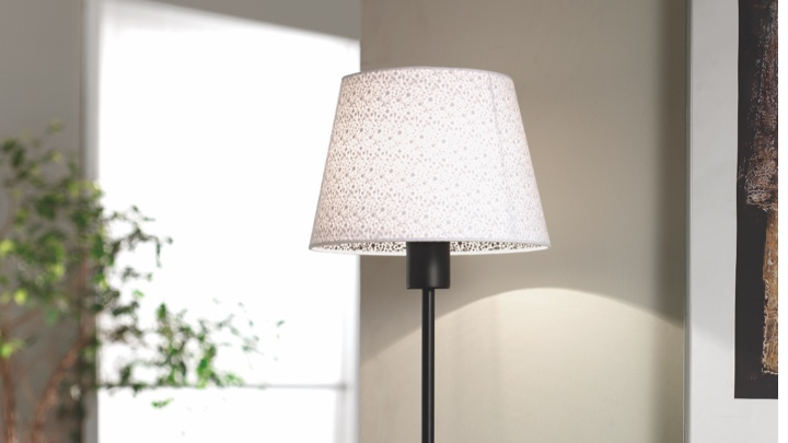 A table lamp on a desk in the hallway