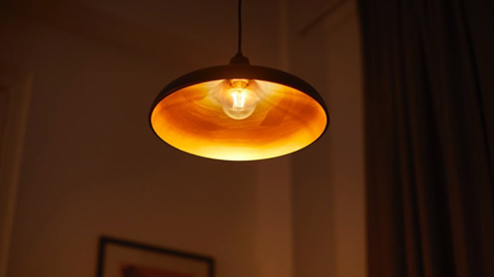 A lamp with a bulb that has a warm cozy glow